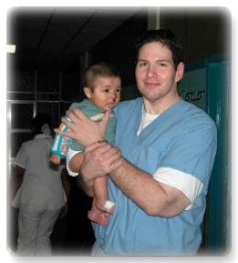 Dr. Lokeh and child in Guatemala